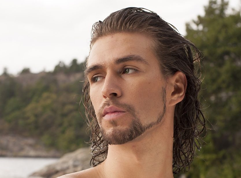 A man outdoors with a long sweep hairstyle from our Bristol salon