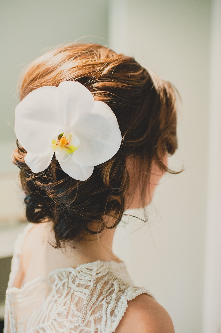 A low curled bun on a bride in Bristol
